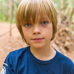 A boy from the Merrohawke Nature School at the Jenny Lagoulis Reservation in Newbury, Massachusetts.