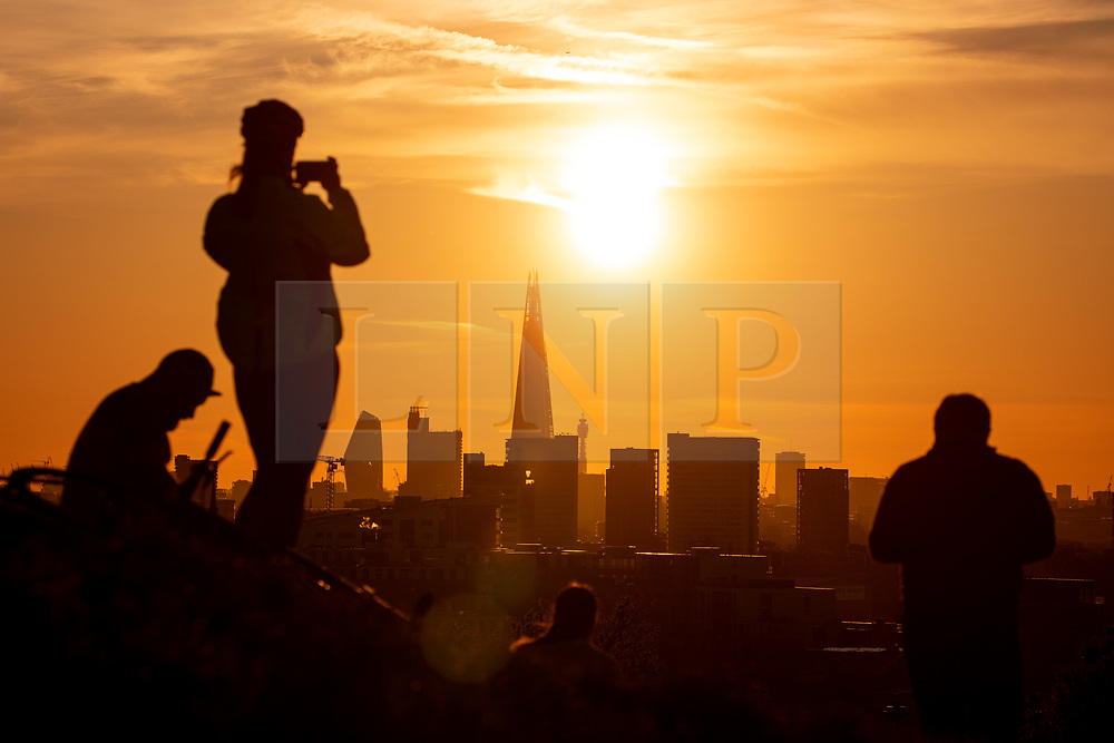 © Licensed to London News Pictures. 13/05/2019. London, UK. The sun sets over the skyline of London after a warm day. Temperatures are set to rise up to 19 degrees Celsius with clear skies in the capital tomorrow. Photo credit : Tom Nicholson/LNP