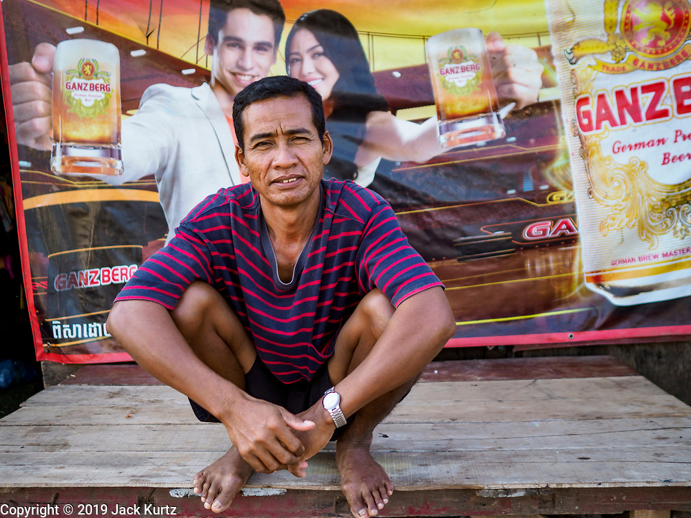 """15 FEBRUARY 2019 - SIHANOUKVILLE, CAMBODIA:  A Cambodian man who lives in a migrant camp in Sihanoukville. He said he came to Sihanoukville because of the town's booming economy. He said he came hoping to get work in the contruction industry. There are about 80 Chinese casinos and resort hotels open in Sihanoukville and dozens more under construction. The casinos are changing the city, once a sleepy port on Southeast Asia's """"backpacker trail"""" into a booming city. The change is coming with a cost though. Many Cambodian residents of Sihanoukville  have lost their homes to make way for the casinos and the jobs are going to Chinese workers, brought in to build casinos and work in the casinos.      PHOTO BY JACK KURTZ"""