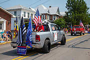 A pickup truck from J Force Trucking is seen with various flags and Trump/Pence sign in the Independence Day Parade in Millville, Pennsylvania on July 5, 2021. (Photo by Paul Weaver)