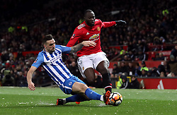 Brighton & Hove Albion's Shane Duffy (left) and Manchester United's Romelu Lukaku battle for the ball during the Emirates FA Cup, quarter final match at Old Trafford, Manchester.