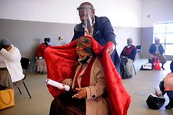 South Africa - Cape Town - 21 July 2020 - Elivia Zimela getting blanket for Anele Gabuza. Celebrating Mandela Day together we fight covid-19 Ward 98  Councilor Anele Gabuza donated blankets and dignity packs to old people in celebration of Mandela day  in Harare Khayelitsha  Photographer Ayanda Ndamane African News Agency(ANA)