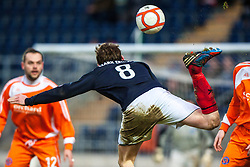 Falkirk's Blair Alston flicks the ball towards Falkirk's Lyle Taylor, who then scored the fourth goal..Falkirk 4 v 1 Forfar Athletic, Scottish Cup fifth round tie, 2/2/2013. .©Michael Schofield.