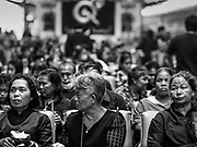 26 OCTOBER 2017 - BANGKOK, THAILAND:  People watch the televised broadcast of the royal funeral in the waiting area of Hua Lamphong train station during the funeral ceremony for Bhumibol Adulyadej, the Late King of Thailand. The king died on 13 October 2016 and was cremated 26 October 2017, after a mourning period of just over one year. The revered monarch was the longest reigning king in Thai history and is credited with guiding Thailand through the turbulent latter half of the 20th century.   PHOTO BY JACK KURTZ