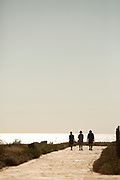 Silhouettes of people by sea in Paphos, Cyprus