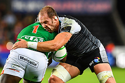 Cherif Traore of Benetton Treviso is tackled by Alun Wyn Jones of Ospreys<br /> <br /> Photographer Craig Thomas/Replay Images<br /> <br /> Guinness PRO14 Round 4 - Ospreys v Benetton Treviso - Saturday 22nd September 2018 - Liberty Stadium - Swansea<br /> <br /> World Copyright © Replay Images . All rights reserved. info@replayimages.co.uk - http://replayimages.co.uk