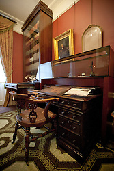 © Licensed to London News Pictures. 10/12/2012. London, UK. The chair and desk of writer Charles Dickens is seen after the Charles Dickens Museum re-opened its doors to the public in London today (10/12/12). The museum, spread over 4 floors, is housed in the building where Dickens lived with his wife from March 1837 to December 1839 and where he authored some of his famous titles including the Pickwick Papers, Nicholas Nickleby and Oliver Twist. Photo credit: Matt Cetti-Roberts/LNP