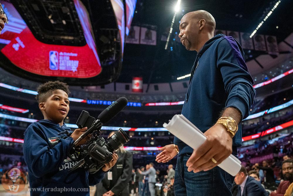 February 15, 2020; Chicago, Illinois, USA; Parker Hamilton (left) interviews Rip Hamilton (right) during NBA All Star Saturday Night at United Center.