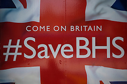 """© Licensed to London News Pictures. 10/06/2016. London, UK. Signs reading """"COME ON BRITAIN #Save BHS in the window of British Homes Stores (BHS) Headquarters in central London. British department store BHS is due to be liquidated after a buyer for the company failed to materialise. Photo credit: Ben Cawthra/LNP"""
