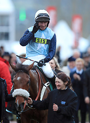 Missed Approach and Mr N McParlan celebrate winning The Fulke Walwyn Kim Muir Challenge Cup Amateur RidersÕ Handicap Chase during St Patrick's Thursday of the 2018 Cheltenham Festival at Cheltenham Racecourse.
