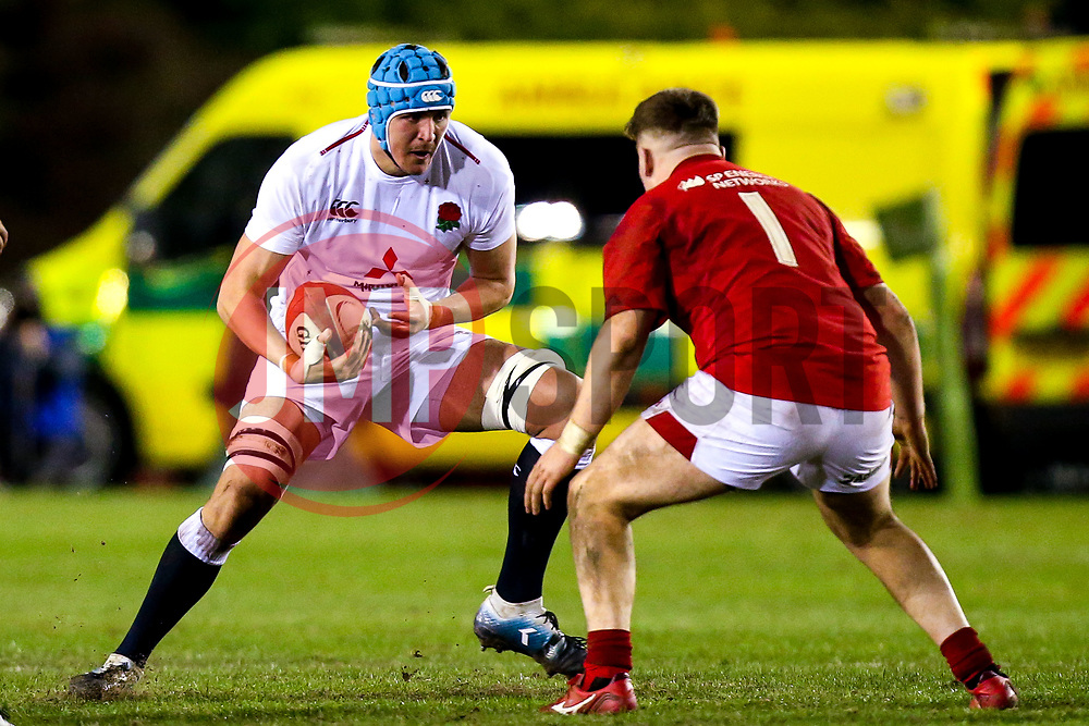 James Scott of England U20 takes on Rhys Davies of Wales U20 - Mandatory by-line: Robbie Stephenson/JMP - 22/02/2019 - RUGBY - Zip World Stadium - Colwyn Bay, Wales - Wales U20 v England U20 - Under-20 Six Nations