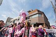 Transvestites from the Elizabeth Club parade a large pink phallus on a mikoshi or portbale shrine during the  Kanamara matsuri or festival of the Steel phallus Kawasaki Daishi, Kawasaki, Kanagawa, Japan. Sunday, April 2nd 2017. The Kanamara Penis festival takes place on the first Sunday of April and celebrates the local legend of a penis eating demon who was defeated after being tricked into biting a steel phallus. The festival is popular with Japan's gay community and now uses its notoriety to raise money for HIV and AIDS charities. It is also wildly popular with foreign and Japanese.tourists.