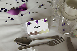 Place setting for bride at wedding.