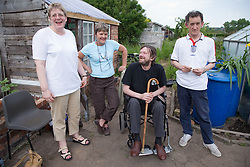 Members of a community allotment; taking a break,