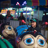 Zy'ev Carruthers rides one of the children's rides at the Zuni fair carnival Thursday in Zuni.