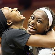 Sisters Chiney Ogwumike, (right), Connecticut Sun and Nneka Ogwumike, Los Angeles Sparks embrace after a television interview before playing against each other for the fist time in the WNBA during the Connecticut Sun Vs Los Angeles Sparks WNBA regular season game at Mohegan Sun Arena, Uncasville, Connecticut, USA. 3rd July 2014. Photo Tim Clayton