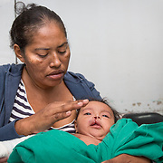 """CAPTION: Lena, Allison's mother, is thrilled with the results of her operation. """"She looks very cute!"""", she exclaims. Allison's father Cesar remarks on how clear the change is, and feels thankful that Allison looks so healthy. He is certain that this surgery will change Allison's life. """"The whole family is so happy!"""", he beems. """"We can now take her out without any fear of reactions from society"""". LOCATION: Hospital Escuela, Tegucigalpa, Honduras. INDIVIDUAL(S) PHOTOGRAPHED: Lena Marivel Martinez Mirtinez (left) and Allison Juliet Lemus Martinez (right)."""