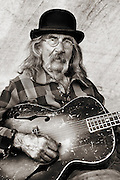 Mad Jack and is weathered guitar at a Mountain Man Rendezvous in West Yellowstone, Montana.