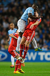 Man City Defender Micah Richards (ENG) and Bayern Midfielder Toni Kroos (GER) collide during the first half of the match - Photo mandatory by-line: Rogan Thomson/JMP - Tel: Mobile: 07966 386802 - 02/10/2013 - SPORT - FOOTBALL - Etihad Stadium, Manchester - Manchester City v Bayern Munich - UEFA Champions League Group D.