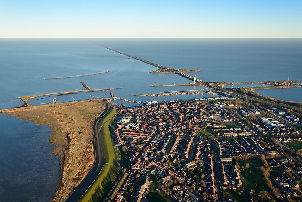 Nederland, Noord-Holland, Den Oever, 11-12-2013; Afsluitdijk met Stevinsluizen gezien vanuit Den Oever. Haven Den Oever, links Waddenzee, rechts IJsselmeer. <br /> Enclosure Dam with Stevin Locks seen from Den Oever. Port of Den Oever, left Waddenzee, IJsselmeer right.<br /> luchtfoto (toeslag op standaard tarieven);<br /> aerial photo (additional fee required);<br /> copyright foto/photo Siebe Swart.