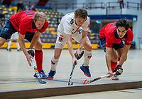 AMSTERDAM -  Tijn Lissone (Adam) met Jordi Schramel (Laren) en Pieter Paul Houting (Laren)   Zaalhockey hoofdklasse, Amsterdam H1-Laren H1 (9-1). COPYRIGHT KOEN SUYK