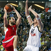 Fenerbahce Ulker's Darjus LAVRINOVIC (R) and Olympiacos's Vassilis SPANOULIS (R) during their Euroleague Basketball Top 16 Game 5 match Fenerbahce Ulker between Olympiacos at Sinan Erdem Arena in Istanbul, Turkey, Thursday, February 24, 2011. Photo by TURKPIX