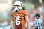 AUSTIN, TX - AUGUST 31: Case McCoy #6 of the Texas Longhorns warms up against the New Mexico State Aggies on August 31, 2013 at Darrell K Royal-Texas Memorial Stadium in Austin, Texas.  (Photo by Cooper Neill/Getty Images) *** Local Caption *** Case McCoy