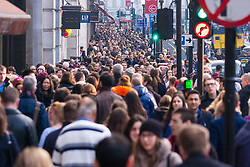 th 2014. Tens of thousands of shoppers flood central London as  Black Friday discounts and most people's pay days kick off the Christmas shopping season in earnest. PICTURED: On Regent Street the pavements are so densely packed that people can barely move.