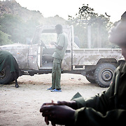 2012-11-20 Au leve du soleil, Nader 19 ans et soldat du SPLA-N (Sudan People Liberation Army North) qui a rejioint l armee a 18 ans, se rememore le temps de paix. La guerre au Sud Kordofan a repris en Juin 2011, suite  a des elections regionales controversees.<br /> Nader n a connu que 6 annees de paix dans sa vie. Tongoli, Sud Kordofan, Soudan.<br /> <br /> Early morning, Nader, 19 year-old rebel who joined the Sudanese People Liberation Army – North when he was 18 thinks about the time when his region wasn't at war. Nader has only know peace for six years in his life, the rest of it was spent at war. Tongoli, South Kordofan, Sudan - November 2012