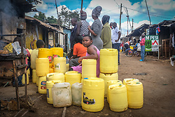 May 5, 2020, Nairobi, Kenya: A group of young ladies waiting in a queue with cans to fetch water during the scarcity of water amidst the ongoing Curfew due to the corona virus pandemic..Across most neighborhoods and the streets of Kibera, local residents are seen wandering around carrying their empty water cans in search of water while some have to queue up for a long period of time in parts where there is access to water. (Credit Image: © Donwilson Odhiambo/SOPA Images via ZUMA Wire)