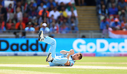 England's Chris Woakes bowls and then catches out India's K. L. Rahul (not pictured) during the ICC Cricket World Cup group stage match at Edgbaston, Birmingham.