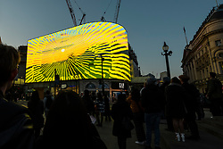 "© Licensed to London News Pictures. 01/05/2021. LONDON, UK.  David Hockney's ""Remember You Cannot Look At The Sun Or Death For Very Long"" artwork, showing an animated sunrise, is displayed on the giant screens at Piccadilly Circus.  It will also be displayed on screens in other cities worldwide including New York, Tokyo and Seoul.  The work, created on an iPad, is supposed to offer a symbol of hope as the world awakens from its long lockdown and also coincides with his upcoming ""The Arrival of Spring"" exhibition at the Royal Academy.  In London, the work is on display nightly for the month of May.  Photo credit: Stephen Chung/LNP"