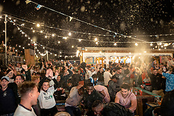 © Licensed to London News Pictures. 07/07/2021. London, UK. Beer flies through the air at Tobacco Dock as the final whistle goes in the Euro 2020 semi-final between England and Denmark. Photo credit: Rob Pinney/LNP
