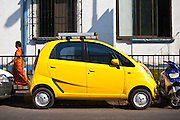 TATA Nano car parked tight in small parking space in Mani Bhavan Marg in  Mumbai, India