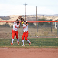 Gallup Bengals Chaylee Becenti (8) and (1)<br /> shortstop Savannah Watson (11) fields a grounder and prepares to throw to first base during their varsity softball game against the Bloomfield Bobcats Friday afternoon at Gallup High School in Gallup.
