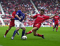 Photo. Glyn Thomas,  Digitalsport<br />Middlesbrough v Everton. Barclaycard Premiership.<br />Riverside Stadium, Middlesbrough. 21/09/2003.<br />Colin Cooper (R) slides in with a tackle to prevent Wayne Rooney from getting a shot in on goal.