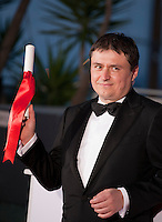 Director Cristian Mungiu with the Award For Best Director Ex-Aequo For Bacalaureat (Graduation) at the Palm D'Or Winners photocall at the 69th Cannes Film Festival Sunday 22nd May 2016, Cannes, France. Photography: Doreen Kennedy