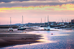 © Licensed to London News Pictures. 26/03/2018. Wells Next The Sea UK. Boats sit on the mud flats in the harbour at dawn this morning in Wells Next The Sea in Norfolk. Photo credit: Andrew McCaren/LNP