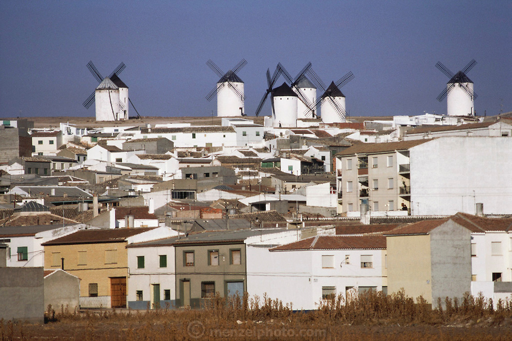Seven whitewashed windmills above the town of Campo de Criptana, La Mancha, La Mancha, Spain.