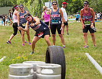 """Team Beer Crew II with Becca, Mary and Betsy watching as Gailyn tries to persuade her shot during the """"Tire Bowling"""" event in the Craft Beer Relay at Gunstock Mountain Resort on Saturday.  (Karen Bobotas/for the Laconia Daily Sun)"""