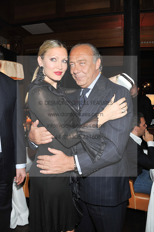 FAWAZ GRUOSI and CAPRICE BOURRET at a dinner hosted by de Grisogono at 17 Berkeley Street, London on 12th November 2012.