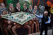 "London, UK. Friday 5th September 2012. 'Freedom for Humanity' a street art graffiti work by artist Mear One aka Kalen Ockerman on Hanbury Street near Brick Lane. Tower Hamlets has ordered that the mural be removed as the characters depicted as bankers have faces that look Jewish, and is therefore antisemitic. In protest the mural had just been sprayed with the Hebrew word 'HAGANAH'. Haganah was a Jewish paramilitary organization in what was then the British Mandate of Palestine from 1920 to 1948, which later became the core of the Israel Defense Forces. Local businessman (pictured), and owner of the wall Azmal Hussein said ""This is not anti-Semitic. This is my wall, my property, and I don't want it to go."""