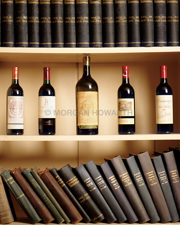 library with books and wine bottles