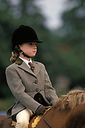 "A young girl sits on her pony, waiting for the beginning of her race at a local gymkhana, on 17th September 1999, in Cheltenham, England. Wearing a smart herringbone patterned jacket, regulation jodhpurs and holding a crop to encourage the horse to perform a series of trick and races, she sits calmly awaiting the next event. The word gymkhana is an Indian Raj term that referred to a place where sporting events took place to test the skill of the competitors. In the UK and east coast of the US, the term gymkhana now almost always refers to an equestrian event for riders on horses, often with the emphasis on children's participation (such as those organised here by the Pony Club). Gymkhana classes include timed speed events such as barrel racing, keyhole, keg race (also known as ""down and back""), flag race, and pole bending."