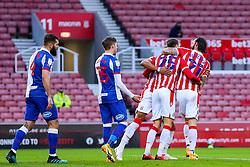 Goalscorer Nick Powell of Stoke City is congratulated by Steven Fletcher - Mandatory by-line: Nick Browning/JMP - 19/12/2020 - FOOTBALL - Bet365 Stadium - Stoke-on-Trent, England - Stoke City v Blackburn Rovers - Sky Bet Championship