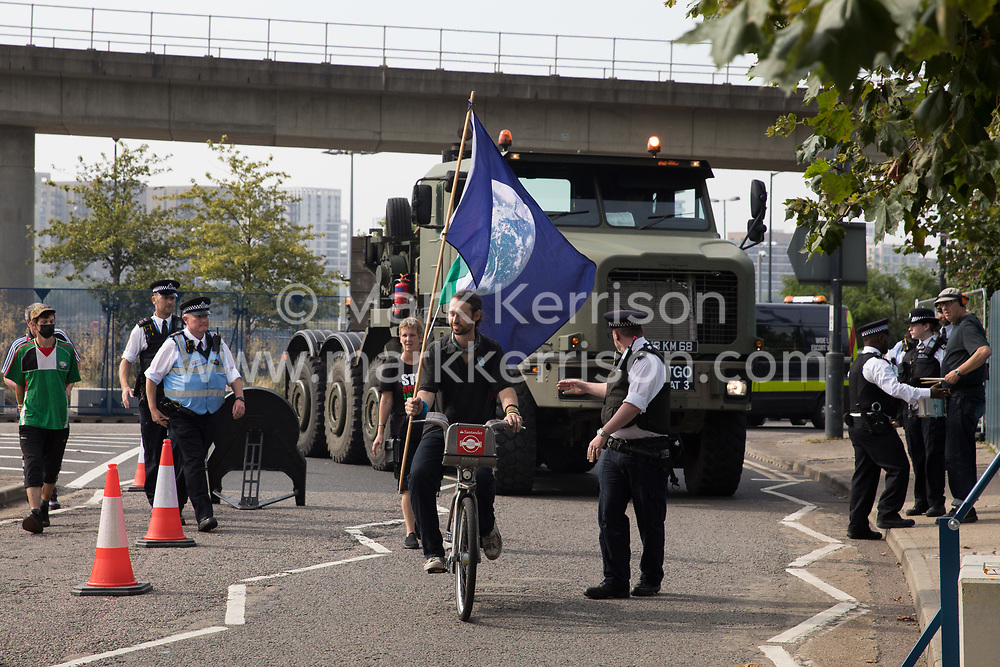 London, UK. 6th September, 2021. Human rights activists protest in front of a large military vehicle against the DSEI 2021 arms fair at ExCeL London. The first day of week-long Stop The Arms Fair protests outside the venue for one of the world's largest arms fairs was hosted by activists calling for a ban on UK arms exports to Israel.