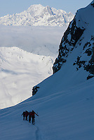 A group of skiers climb toward the Plateau du Couloir along the classic Haute Route in Switzerland.