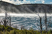Powerful winds whip spray from Skottsberg lake. Torres del Paine National Park is listed as a World Biosphere Reserve by UNESCO. Near Puerto Natales, Ultima Esperanza Province, Chile, Patagonia, South America.