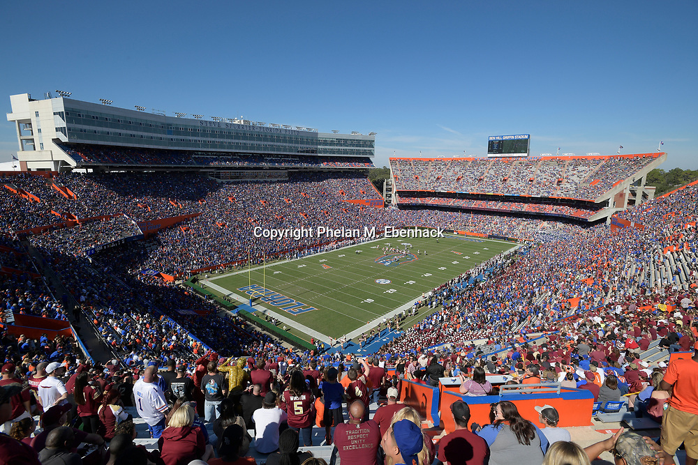 Fans watch from the stands during the first half of an NCAA college football game between Florida and Florida State Saturday, Nov. 25, 2017, in Gainesville, Fla. (Photo by Phelan M. Ebenhack)