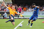 AFC Wimbledon striker Andy Barcham (17) and AFC Wimbledon defender Chris Roberston (34) battles for possession during the EFL Sky Bet League 1 match between AFC Wimbledon and Oldham Athletic at the Cherry Red Records Stadium, Kingston, England on 21 April 2018. Picture by Matthew Redman.
